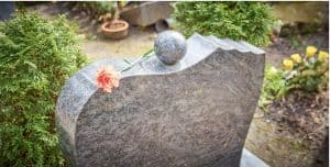 A headstone with a single flower